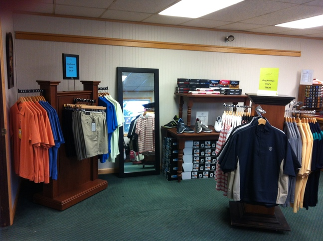 Men's golf merchandise in the pro shop at Lost Creek